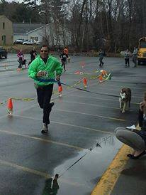 Metoulin, the dog, and David Sagger, bib number 117, crossing finish line on April 27, 2014! David Sagger was also in the first race for the Animal Orphanage back in 1994!! (courtesy photo)