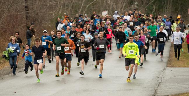 The crowd of runners and walkers are off at the start of the Turkey Trot 5K. (Photo by Ron Hawkes)