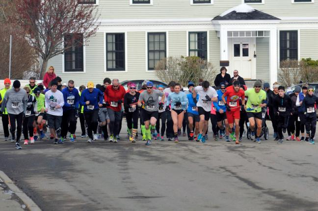 The race is off as 77 people ran and walked to start the year off right. (Photo by Ron Hawkes)