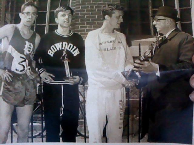 "L--R....Paul Liming, Lewiston, 1st H.S., ""Chuck"" Farwell, 4:13 miler, handing out the trophies in April, 1966, Bart Peverada, director of Patriots Day 5-miler in Portland, Maine."